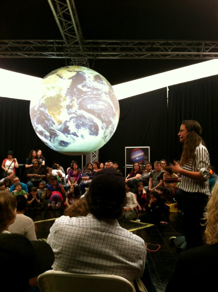 "Vicky Weeks presents her film ""Our Pale Blue Dot"" to an audience at the World Science Festival in New York City."